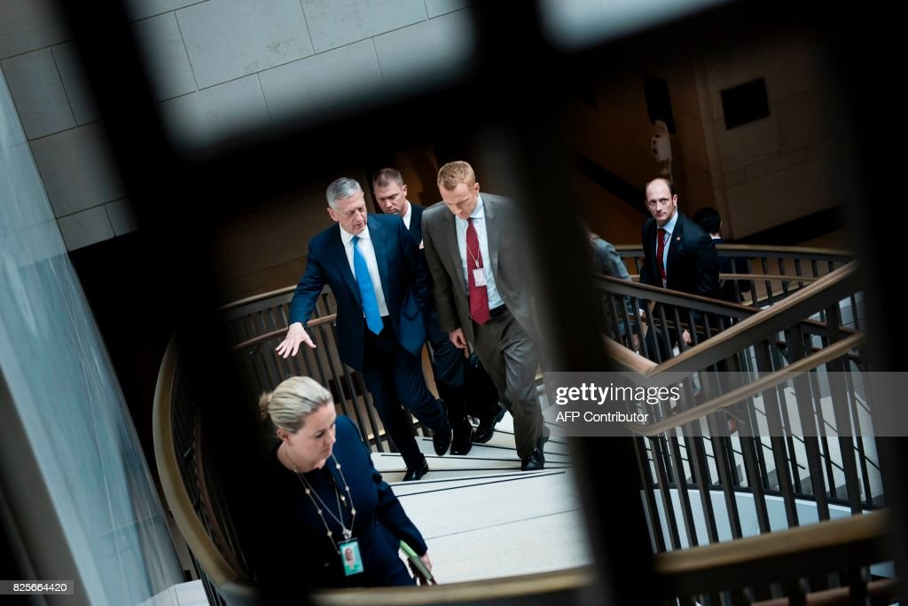 US Secretary of Defense James Mattis leaves with others after attending a closed meeting of the Senate Foreign Relations Committee on Capitol Hill August 2, 2017 in Washington, DC. / AFP PHOTO / Brendan Smialowski