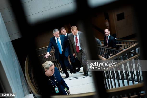 US Secretary of Defense James Mattis leaves with others after attending a closed meeting of the Senate Foreign Relations Committee on Capitol Hill...