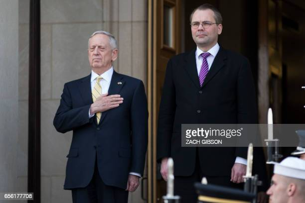 US Secretary of Defense James Mattis listen to national anthems with Finnish Minister of Defense Jussi Niinisto while hosting an honor cordon at The...