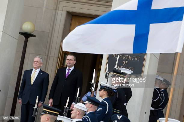 US Secretary of Defense James Mattis listens to national anthems with Finnish Minister of Defense Jussi Niinisto while hosting an honor cordon at The...
