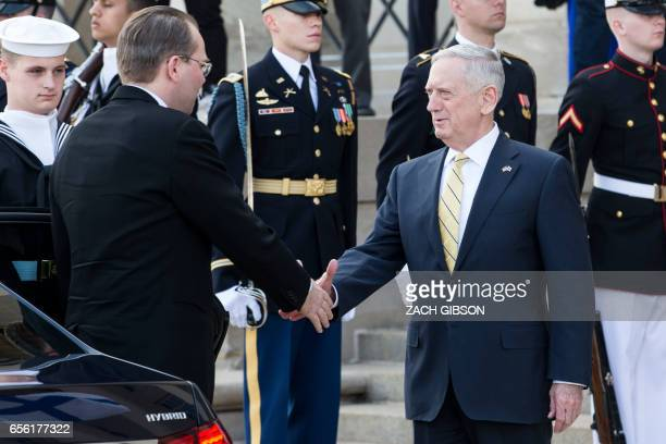 US Secretary of Defense James Mattis shakes hands with Finnish Minister of Defense Jussi Niinisto while hosting an honor cordon at The Pentagon March...