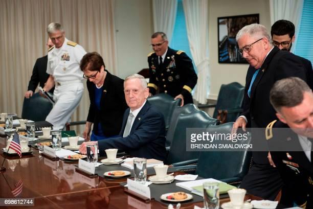 US Secretary of Defense James Mattis takes his seat for a meeting with Ukraine's President Petro Poroshenko at the Pentagon on June 20 2017 in...