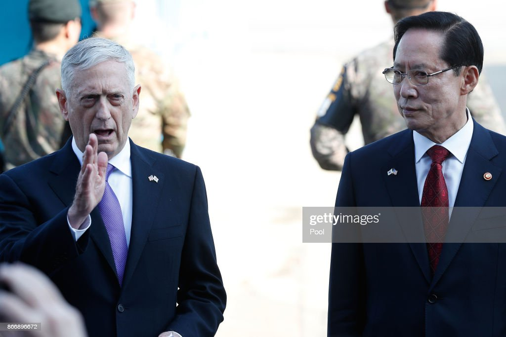 U.S. Secretary of Defense James Mattis (L) talks with South Korean Defense Minister Song Young-moo (R) at the truce village of Panmunjom in the Demilitarized Zone (DMZ) on October 27, 2017 in Panmunjom, South Korea. Mattis is in South Korea ahead of the visit by U.S. President Donald Trump.