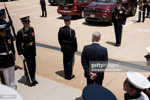 US Secretary of Defense James Mattis waits to greet Ukraine's President Petro Poroshenko outside the Pentagon on June 20 2017 in Washington DC / AFP...