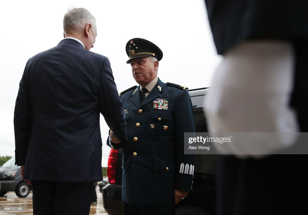 U.S. Secretary of Defense James Mattis (L) welcomes Mexican Secretary of National Defense Gen. Salvador Cienfuegos Zepeda (R) to the Pentagon during an enhanced honor cordon to May 22, 2017 in Arlington, Vriginia. Secretary Mattis is holding talks with his counterparts of Mexico and Canada today.