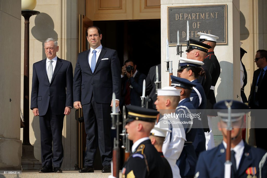 U.S. Secretary of Defense James Mattis (L) welcomes Tunisian Prime Minister Youssef Chahed during an honor cordon ceremony at the Pentagon July 10, 2017 in Arlington, Virginia. Chahed will participate in bilateral meetings with Vice President Mike Pence later in the day.