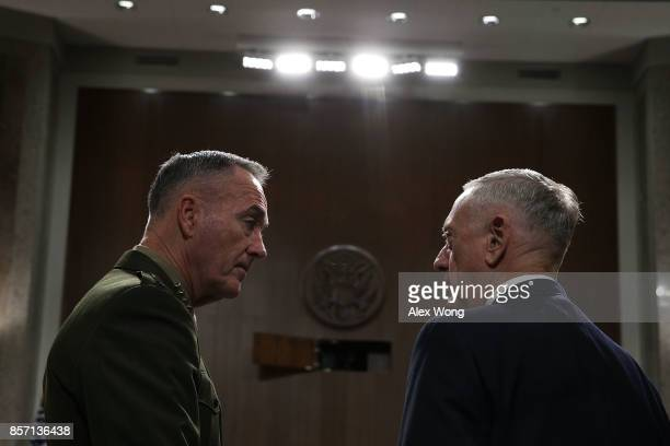 S Secretary of Defense Jim Mattis and Chairman of the Joint Chiefs of Staff General Joseph Dunford wait for the beginning of a hearing before Senate...
