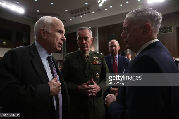 S Secretary of Defense Jim Mattis and Chairman of the Joint Chiefs of Staff General Joseph Dunford listen to committee chairman Sen John McCain prior...