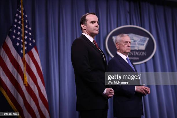 S Secretary of Defense Jim Mattis and Special Presidential Envoy for the Global Coalition to Counter ISIS Brett McGurk listen to questions from...