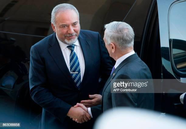 US Secretary of Defense Jim Mattis greets Israeli Defence minister Avigdor Lieberman prior to their meeting at the Pentagon in Arlington Virginia on...