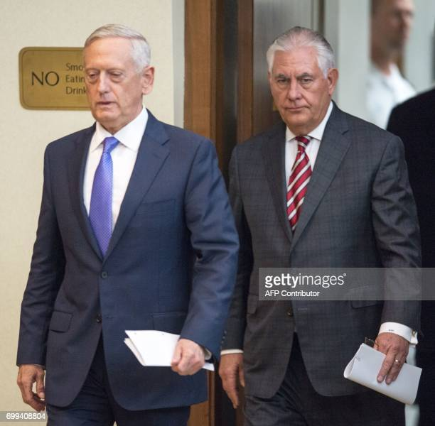US Secretary of Defense Jim Mattis is followed by US Secretary of State Rex Tillerson to conduct a two question press conference after meeting with...