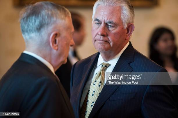 Secretary of Defense Jim Mattis left talks with Secretary of State Rex Tillerson before President Donald Trump speaks at a dinner with Indian Prime...