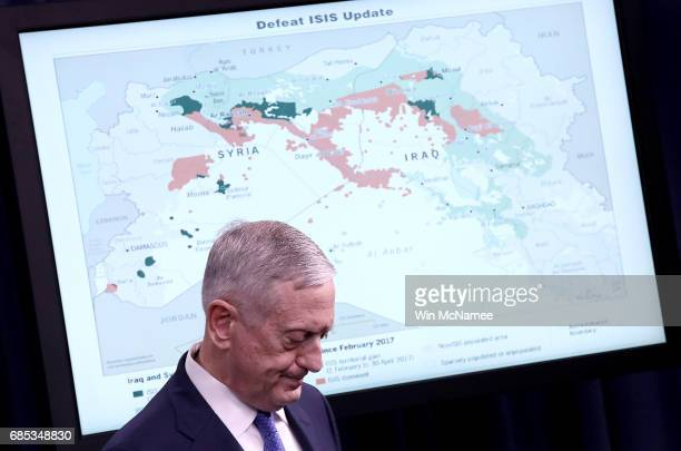 S Secretary of Defense Jim Mattis listens to questions from reporters during a Pentagon briefing May 19 2017 in Arlington Virginia Mattis Dunford and...