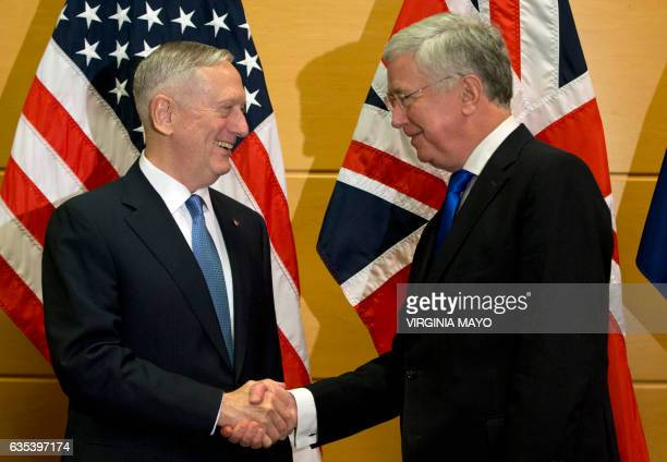 US Secretary of Defense Jim Mattis shakes hands with British Secretary of State for Defense Michael Fallon during a meeting at NATO headquarters in...