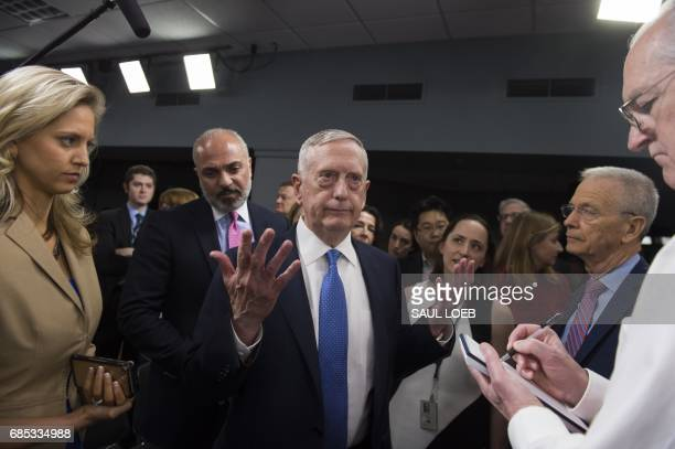 US Secretary of Defense Jim Mattis speaks with members of the media prior to a press briefing at the Pentagon in Washington DC May 19 2017 Pentagon...