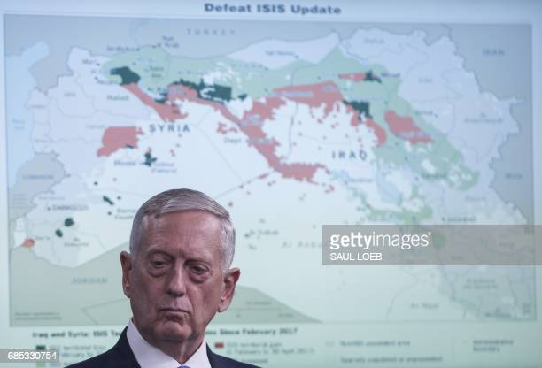 US Secretary of Defense Jim Mattis stands near a map of the Middle East as he holds a press briefing at the Pentagon in Washington DC May 19 2017...
