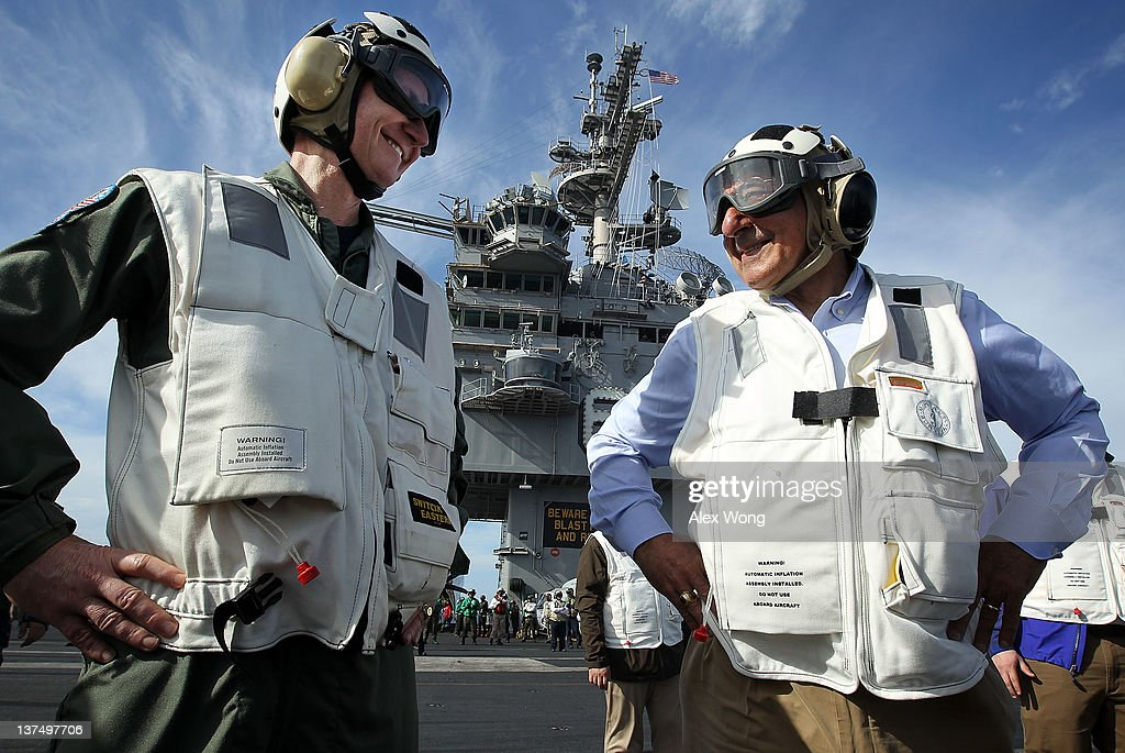 U.S. Secretary of Defense Leon E. Panetta (R), escorted by Commander of Strike Group Twelve Rear Admiral Walter E. Carter, Jr. (L), watches day flight operations from the flight deck of the aircraft carrier USS Enterprise January 21, 2012 off of the southeastern coast of the United States. Secretary Panetta visited the crew onboard the ship, where he will spend the night. The ship is scheduled for deactivating in November, 2012.
