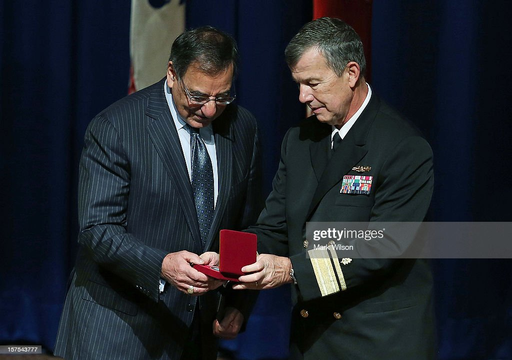 U.S. Secretary of Defense Leon E. Panetta (L) is presented with a Commemorative coin by Commander Rear Adm. Alton L. Stocks during an event at the Walter Reed National Military Medical Center, on December 4, 2012 in Bethesda, Maryland. Secretary Panetta spoke to medical center staff before presenting them with a gift.