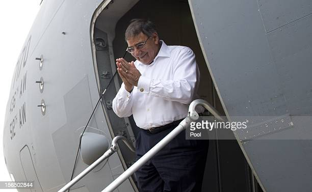 Secretary of Defense Leon Panetta acknowledges his hosts as he boards his military aircraft prior to departing Siem Reap Airport after attending the...
