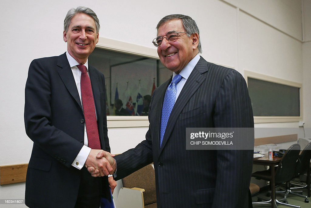 US Secretary of Defense Leon Panetta (R) and British Defense Secretary Philip Hammond pose for photographs before a bilateral meeting during the North Atlantic Treaty Organization (NATO) Defense Ministers Meetings at NATO headquarters on February 22, 2013 in Brussels, Belgium. Panetta is attending meetings and holding bilateral meetings with other NATO defense officials.