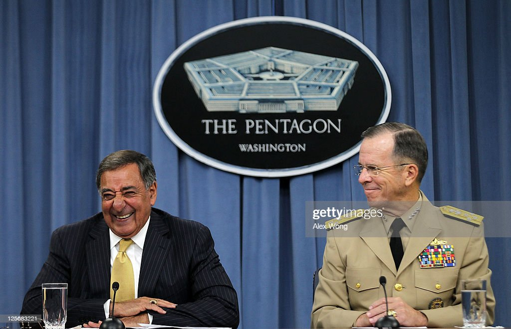 U.S. Secretary of Defense Leon Panetta (L) and Chairman of the Joint Chiefs of Staff Admiral Mike Mullen (R) laugh during a briefing at the Pentagon briefing room September 20, 2011 in Arlington, Virginia. The Pentagon has officially ended the 'Don't Ask, Don't Tell' policy that has prevented gay people to serve in the military openly.