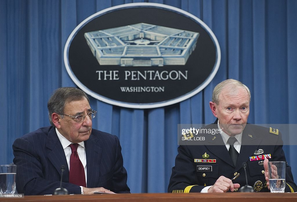 US Secretary of Defense Leon Panetta and Chairman of the Joint Chiefs of Staff Martin Dempsey (R) speak during a press conference at the Pentagon in Washington, DC, on January 10, 2013. The United States is increasingly focused on how to secure Syria's chemical weapons if President Bashar al-Assad falls from power but is not considering sending ground troops, Panetta said. AFP PHOTO / Saul LOEB