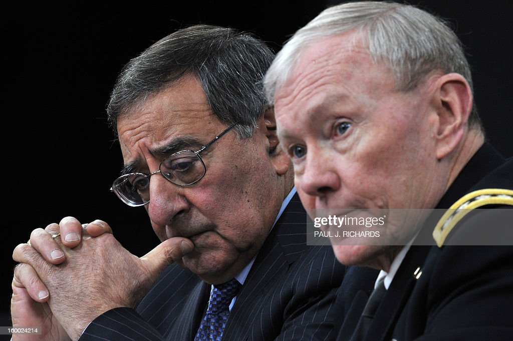 US Secretary of Defense Leon Panetta and Chairman of the Joint Chiefs of Staff General Martin E. Dempsey (R) announce lifting the ban on women serving in front line combat roles during a media briefing January 24, 2013 at the Pentagon in Washington,DC. The announcment will open up hundreds of thousands of frontline positions for women in the infantry, tank, and in commando units. AFP Photo/Paul J. Richards