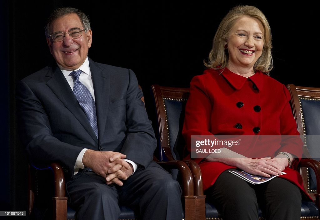 US Secretary of Defense Leon Panetta and former Secretary of State Hillary Clinton laugh prior to Clinton receiving the Department of Defense Medal for Distinguished Public Service during a ceremony at the Pentagon in Washington, DC, February 14, 2013. AFP PHOTO / Saul LOEB