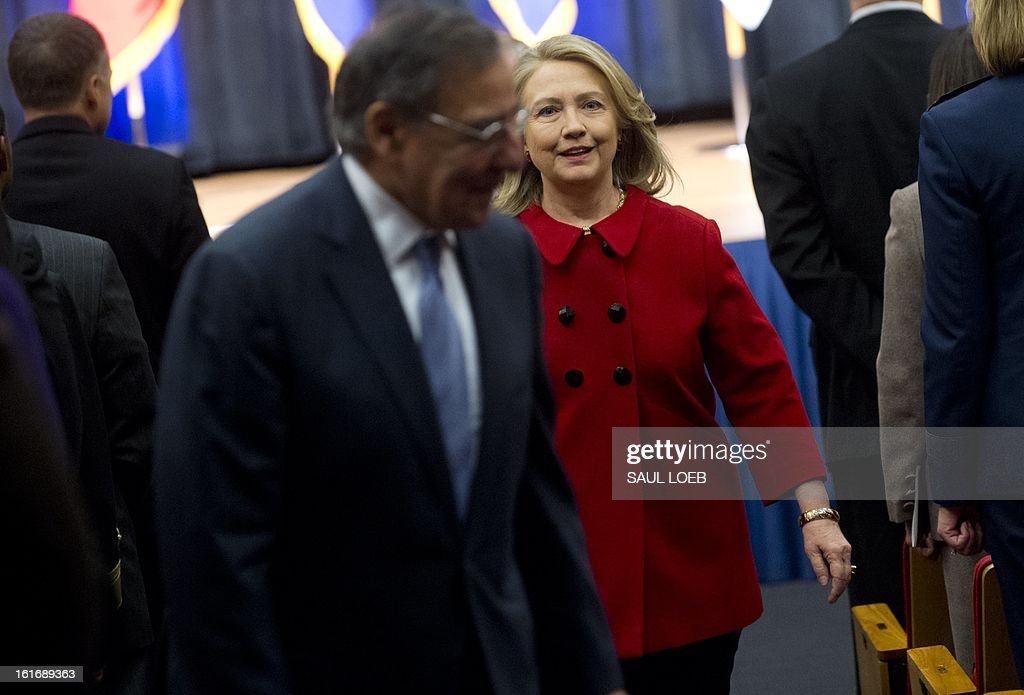 US Secretary of Defense Leon Panetta and former Secretary of State Hillary Clinton leave after Panetta presented Clinton with the Department of Defense Medal for Distinguished Public Service during a ceremony at the Pentagon in Washington, DC, February 14, 2013. AFP PHOTO / Saul LOEB