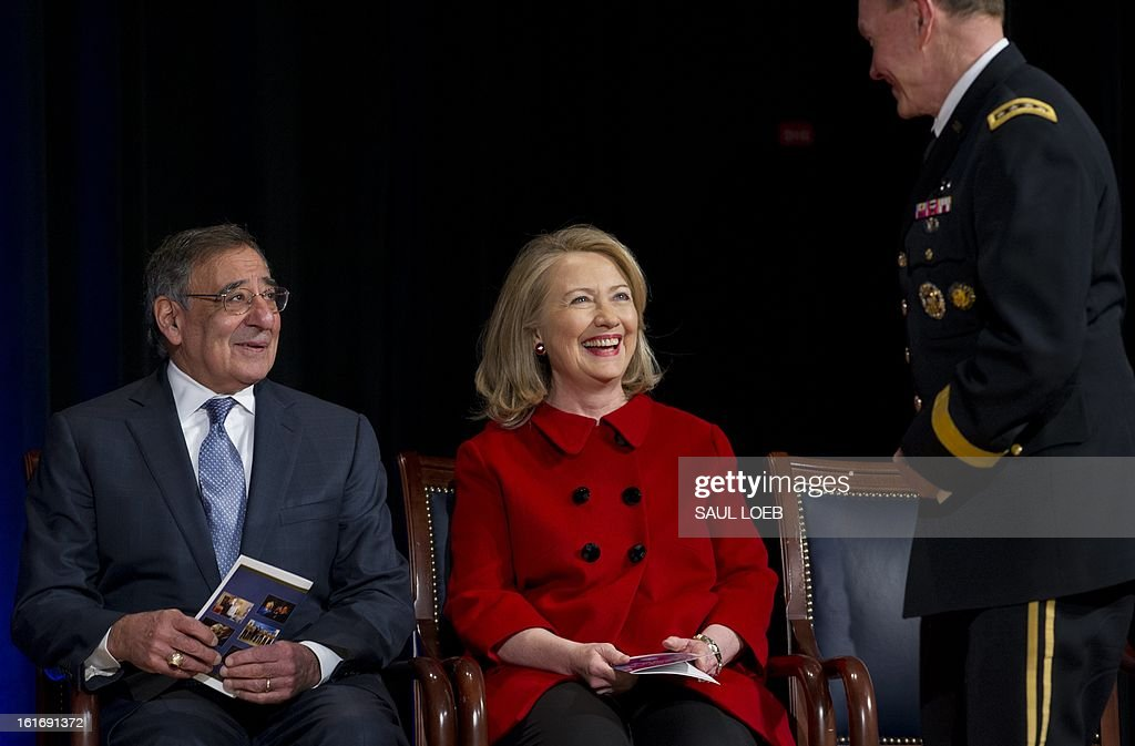 US Secretary of Defense Leon Panetta and former Secretary of State Hillary Clinton speak with Chairman of the Joint Chiefs Martin Dempsey (R) prior to Clinton receiving awards from Panetta and Dempsey during a ceremony at the Pentagon in Washington, DC, February 14, 2013. AFP PHOTO / Saul LOEB