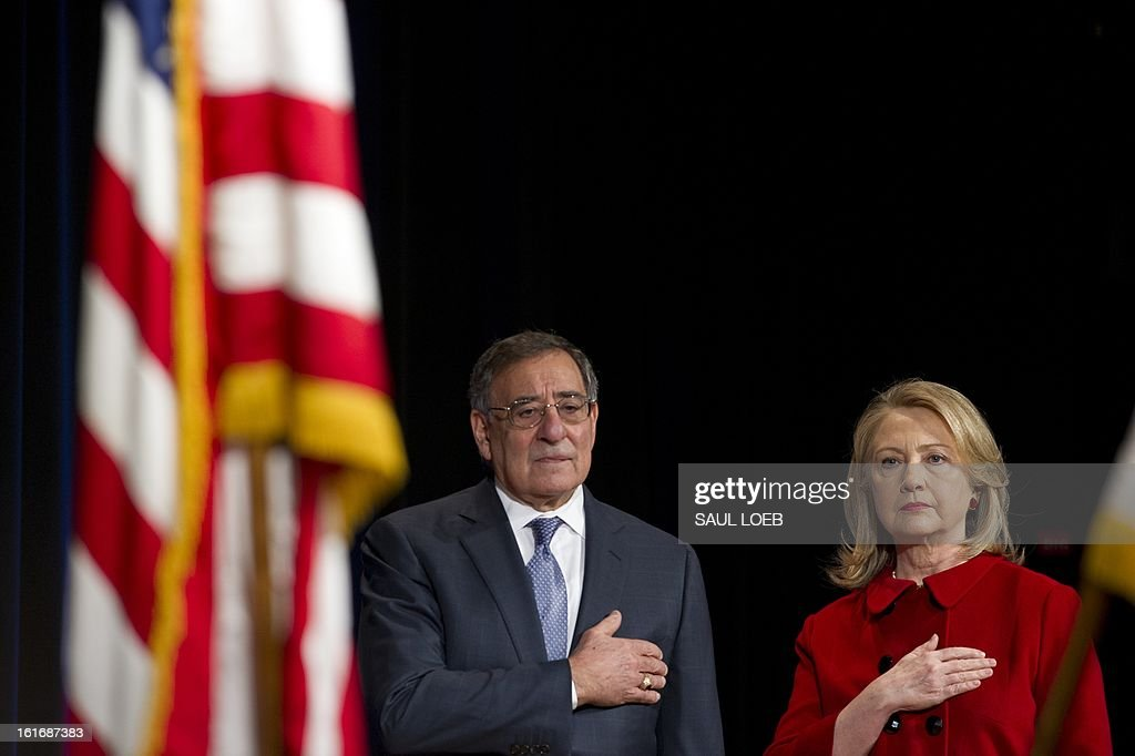 US Secretary of Defense Leon Panetta and Secretary of State Hillary Clinton stand during the National Anthem prior to Clinton receiving the Department of Defense Medal for Distinguished Public Service during a ceremony at the Pentagon in Washington, DC, February 14, 2013. AFP PHOTO / Saul LOEB