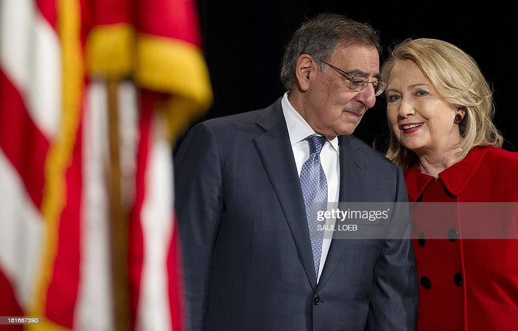 US Secretary of Defense Leon Panetta and Secretary of State Hillary Clinton speak prior to Clinton receiving the Department of Defense Medal for Distinguished Public Service during a ceremony at the Pentagon in Washington, DC, February 14, 2013. AFP PHOTO / Saul LOEB