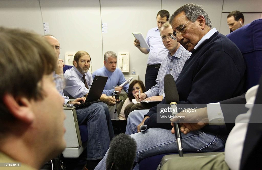 S Secretary of Defense Leon Panetta answers questions aboard an Air Force plane over the Atlantic Ocean on October 2 2011 Panetta is traveling to the...