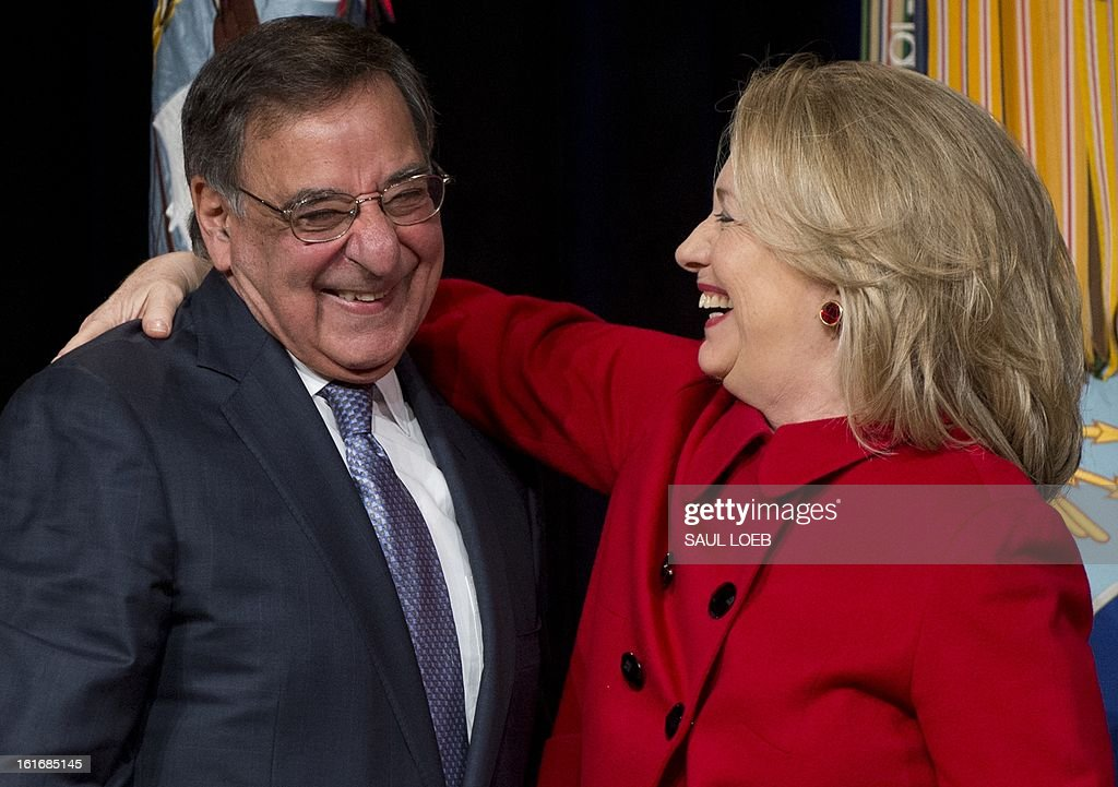 US Secretary of Defense Leon Panetta embraces former Secretary of State Hillary Clinton prior to presenting her with the Department of Defense Medal for Distinguished Public Service during a ceremony at the Pentagon in Washington, DC, February 14, 2013. AFP PHOTO / Saul LOEB