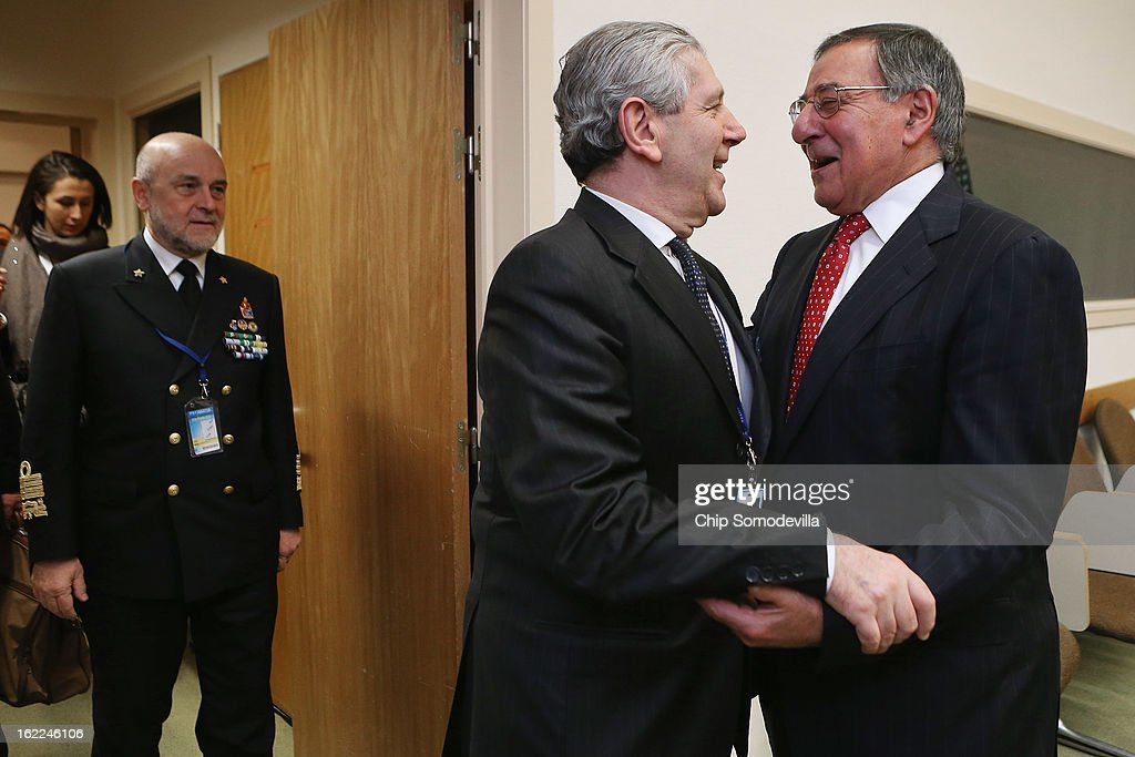 U.S. Secretary of Defense Leon Panetta (R) embraces Italy Defense Minister Giampaolo Di Paola before a meeting at the North Atlantic Treaty Organization (NATO) headquarters on February 21, 2013 in Brussels, Belgium. Panetta is attending NATO Defense Ministers Meetings and holding bilateral meetings with other international officials.