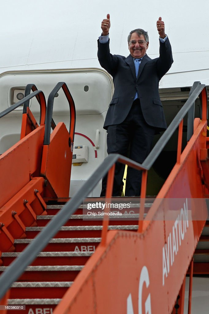 S Secretary of Defense Leon Panetta gives a thumbsup before boarding his aircraft and departing February 22 2013 in Brussels Belgium Panetta attended...