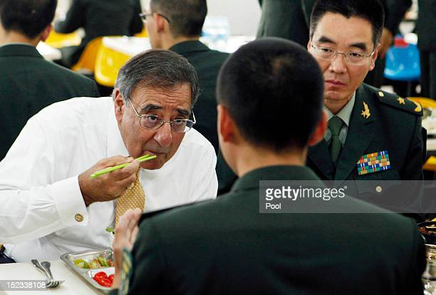 S Secretary of Defense Leon Panetta has lunch with cadets in the mess hall at the PLA Engineering Academy of Armored Forces on September 19 2012 in...