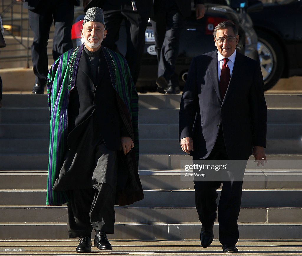 U.S. Secretary of Defense Leon Panetta (R) hosts a full military honors ceremony welcoming Afghan President <a gi-track='captionPersonalityLinkClicked' href=/galleries/search?phrase=Hamid+Karzai&family=editorial&specificpeople=121540 ng-click='$event.stopPropagation()'>Hamid Karzai</a> to the Pentagon January 10, 2013 in Arlington, Virginia. Karzai is on a visit in Washington, to include a meeting with U.S. President Barack Obama at the White House, to discuss the continued transition in Afghanistan and the partnership between the two nations.