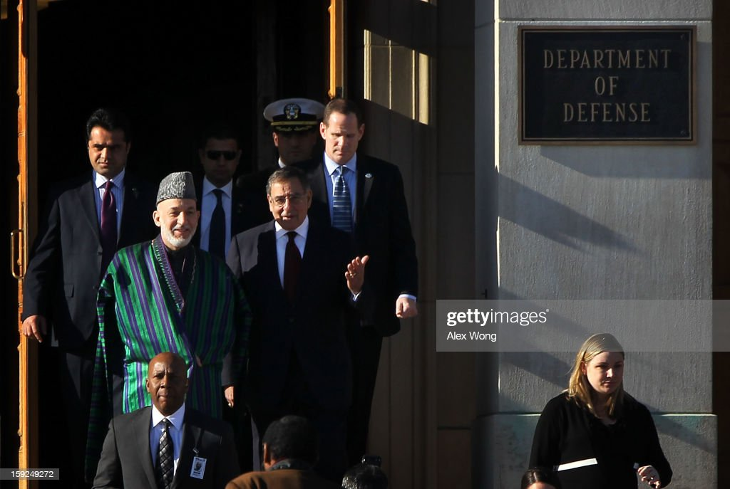 U.S. Secretary of Defense Leon Panetta (R) hosts a full military honors ceremony welcoming Afghan President Hamid Karzai (L) to the Pentagon January 10, 2013 in Arlington, Virginia. Karzai is on a visit in Washington, to include a meeting with U.S. President Barack Obama at the White House, to discuss the continued transition in Afghanistan and the partnership between the two nations.