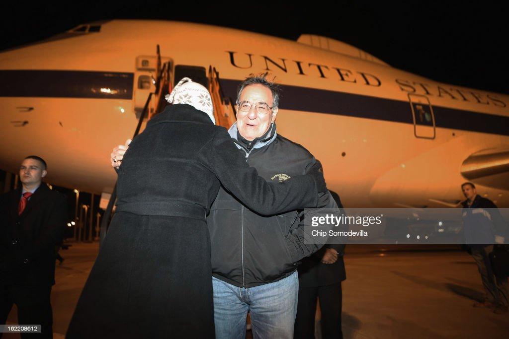 U.S. Secretary of Defense Leon Panetta (R) is greetd after steping off the E-4B aircraft after landing February 20, 2013 in Brussels, Belgium. Panetta is in Brussels for a meeting of NATO defense ministers.