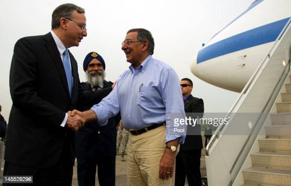 S Secretary Of Defense Leon Panetta is watched by Commander Air Power Generation Command Colonel Sarbjit Singh as he shakes hands with US Ambassador...