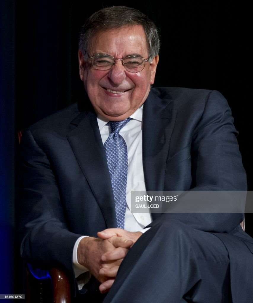 US Secretary of Defense Leon Panetta laughs after presenting former Secretary of State Hillary Clinton with the Department of Defense Medal for Distinguished Public Service during a ceremony at the Pentagon in Washington, DC, February 14, 2013. AFP PHOTO / Saul LOEB