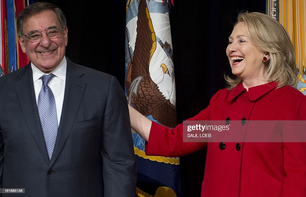 US Secretary of Defense Leon Panetta laughs alongside former Secretary of State Hillary Clinton prior to presenting her with the Department of Defense Medal for Distinguished Public Service during a ceremony at the Pentagon in Washington, DC, February 14, 2013. AFP PHOTO / Saul LOEB