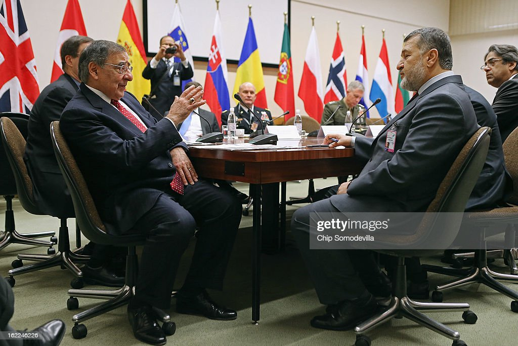 U.S. Secretary of Defense Leon Panetta (L) meets with Afghanistan Defense Minister Bismillah Khan Mohammadi (2nd R) and members of his delegation at the North Atlantic Treaty Organization (NATO) headquarters on February 21, 2013 in Brussels, Belgium. Panetta is attending NATO Defense Ministers Meetings and holding bilateral meetings with other international officials.
