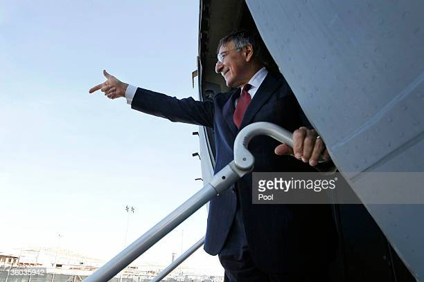 S Secretary of Defense Leon Panetta points as he says goodbye on board a C17 plane ready to leave Tripoli on December 17 2011 in Tripoli Libya...
