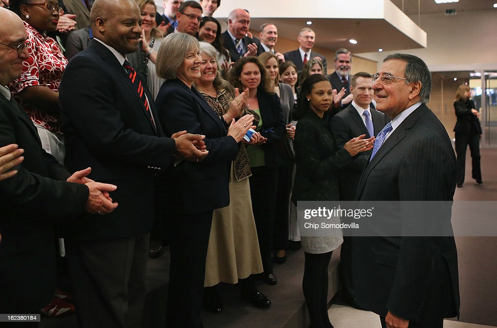 U.S. Secretary of Defense Leon Panetta (R) receives a round of applause from the US-NATO staff after attending the North Atlantic Treaty Organization (NATO) Defense Ministers Meetings at NATO headquarters February 22, 2013 in Brussels, Belgium. Panetta is attended meetings and holding bilateral meetings with other NATO defense officials.