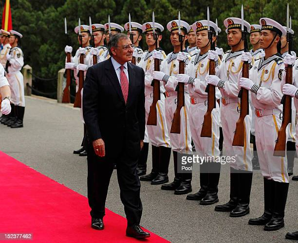 S Secretary of Defense Leon Panetta reviews a naval honor guard before touring Chinese naval vessels of the North Sea Fleet on September 20 2012 in...