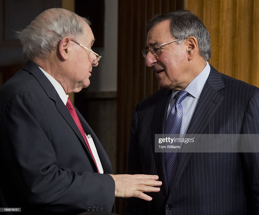 Secretary of Defense Leon Panetta, right, and Chairman Carl Levin, D-Mich., talk before a Senate Armed Services Committee hearing featuring testimony by Panetta and Chairman of the Joint Chiefs of Staff Gen. Martin Dempsey, on the Defense Department's response to the attack on U.S. embassy in Benghazi, Libya, and discuss the findings of its internal review of the attack.
