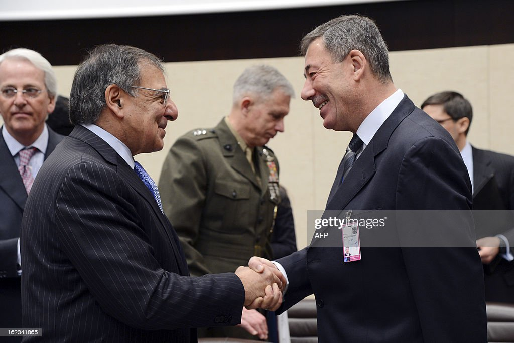 US Secretary of Defense Leon Panetta (L) shakes hands with Jordan's Minister of Defense Montaser Oklah Alzoubi (R) prior to the start of the North Atlantic Council meeting of Ministers of Defense and ISAF partners at NATO headquarters in Brussels on February 22, 2013.