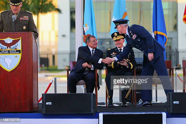 S Secretary of Defense Leon Panetta shakes hands with US Air Force General Douglas Fraser as US Army General Martin Dempsey Chairman Joint Chiefs of...
